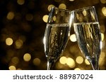 flutes of champagne in holiday... | Shutterstock . vector #88987024