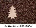Fir tree made of roasted coffee beans on burlap - stock photo