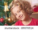 little girl at a Christmas fir-tree. - stock photo