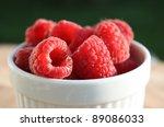 Jar of red raspberries - stock photo