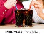 Couple Drinking Soda In A Bar...