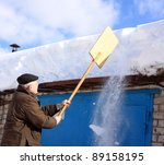 Man Removing Snow From A Roof...