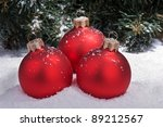 Christmas spheres on snow and a pine on a back background - stock photo