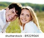 happy beautiful couple on nature | Shutterstock . vector #89229064