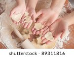 Mother and daughter make biscuits. only the hands - stock photo