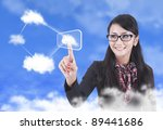 Asian woman touching a touchscreen with cloud networking concept - stock photo