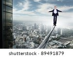 business man balancing on the... | Shutterstock . vector #89491879