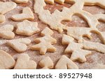 Gingerbread cookies shape on a table full of flour - stock photo