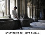 Woman meditating in the cloister of a convent in Salamanca, Castilla León, Spain - stock photo