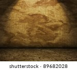 Grunge room with a stone wall and floor - stock photo