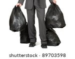 Businessman taking out the trash concept for leadership, starting over or new beginnings - stock photo