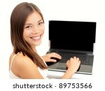 laptop woman happy. Asian girl sitting with laptop computer notebook smiling isolated on white background. - stock photo