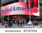 NEW YORK - DEC 30: Pedestrians walk past a Bank of America branch in Times Square in New York City, New York, on Wednesday,  December 30, 2009. - stock photo