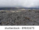 Volcanic lava field on Big island, Hawaii on a cloudy day. - stock photo