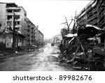 SARAJEVO, BOSNIA - MAR 15: Crushed buses and the  debris of war line a street of blown up buildings in Sarajevo, Bosnia, on Friday, March 15, 1996. - stock photo