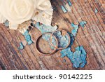 Wedding Rings On Grunge Wooden...
