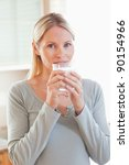 young woman drinking some water | Shutterstock . vector #90154966
