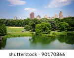 A pond in New York City Central Park in summer with a view of Manhattan skyscrapers and colorful trees - stock photo