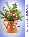 Christmas card. Brunches of Christmas tree and holly berry in decorated jar. - stock photo