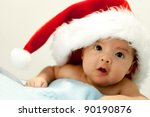 Cute Baby With Santa Hat On Hi...