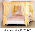 Luxurious canopy bed - stock photo