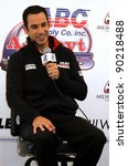 MILWAUKEE, WI - MAY 29: INDYCAR IRL driver Helio Castroneves interviewed after his return to Team Penske May 29, 2009 in Milwaukee, WI. Helio won the Indy 500 for the third time the week before. - stock photo