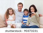 young family watching television | Shutterstock . vector #90373231