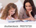 little girl reading bedtime... | Shutterstock . vector #90373720