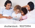 young family sitting on the bed ... | Shutterstock . vector #90375994