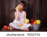 a cute young girl eating an... | Shutterstock . vector #9052741