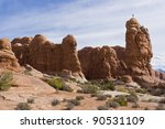 Climbers on top of the rock in Arches National Park. Utah, USA - stock photo