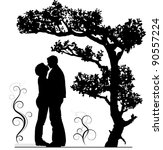 Two lovers embraces under a tree. A silhouette, a vector illustration.