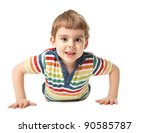 cheerful smiling little boy lying on the floor. Isolated on white background.  shooting in the studio - stock photo