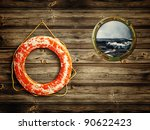 Lifebuoy And Porthole With Sea...