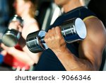 strong man with dumbbells  in... | Shutterstock . vector #9066346