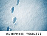 Snow texture with foot prints - stock photo
