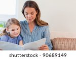mother reading a book to her... | Shutterstock . vector #90689149