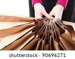 Shopping brown recycle gift bags in woman hand background - stock photo
