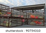 Large crab pots stacked at the commercial fishing dock at Homer, Alaska during the off season. - stock photo