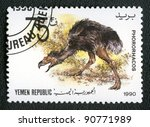 YEMEN REPUBLIC - CIRCA 1990: A stamp printed in Yemen shows Phororhacos, series devoted to prehistoric animals, circa 1990. - stock photo