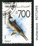 YEMEN REPUBLIC - CIRCA 1990: A stamp printed in Yemen shows Ichtyosaurus, series devoted to prehistoric animals, circa 1990. - stock photo