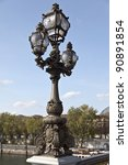 Ornate lamp post along the Pont Alexandre III in Paris - stock photo