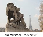 Famous landmark of Paris, Eiffel Tower, as seen from bridge and lion statue near Great palace - stock photo