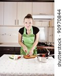 young woman cooks dinner in the ...
