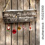 wooden plaque with a christmas...