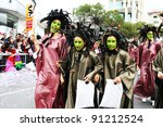 LIMASSOL,CYPRUS-MARCH 6, 2011:Unidentified women in medusa costumes during the carnival parade, established in 16th century, influenced by Venetian traditions. - stock photo