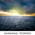 A Sunrise Over Dark Water Of...