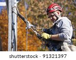 Climber on cell tower in autumn scennery - stock photo