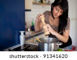 woman with a pepper mill - stock photo