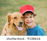 boy and golden retriever | Shutterstock . vector #9138616